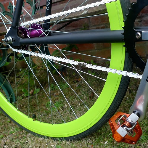 orange pedals with green wheels