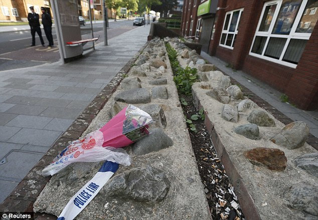 Tribute: Flowers lie near the crime scene where one man was killed in Woolwich, south-east London