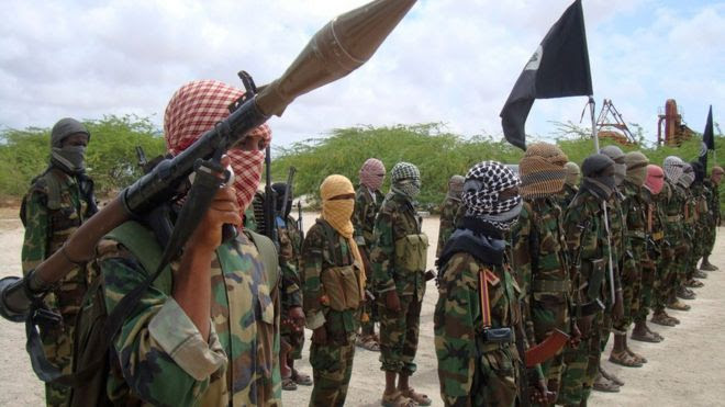 file photo of Thursday Oct.21, 2010, Al-Shabaab fighters display weapons as they conduct military exercises in northern Mogadishu, Somalia.