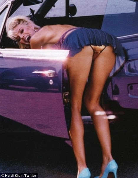 Flash back: Heidi Klum tweeted this vintage shot of herself leaning into a car today