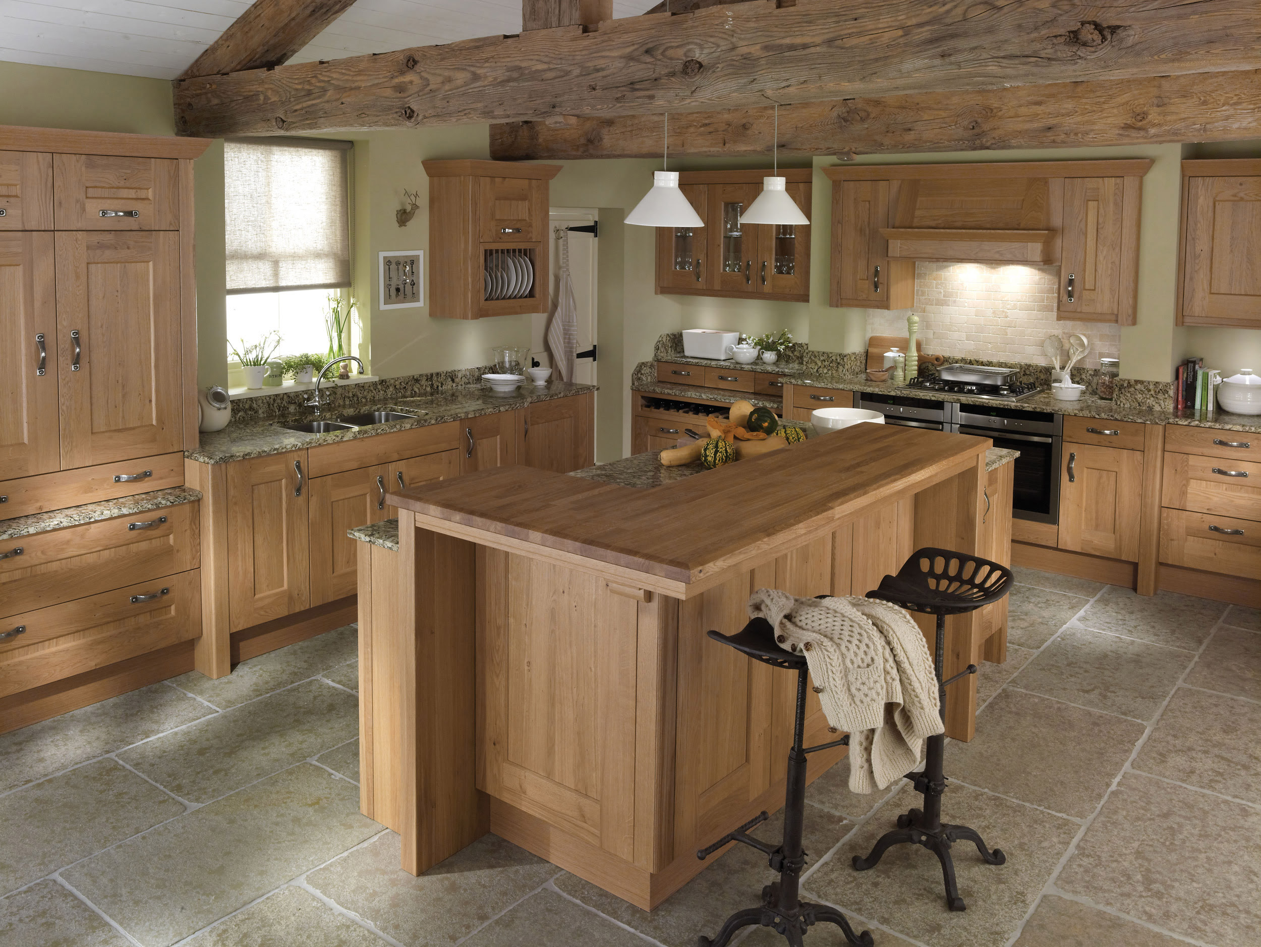 Rustic Kitchen Island Wooden Made Furnished with Black High Chairs