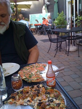 Ted Killian and I eating vegan pizza at Pizza Research Institute