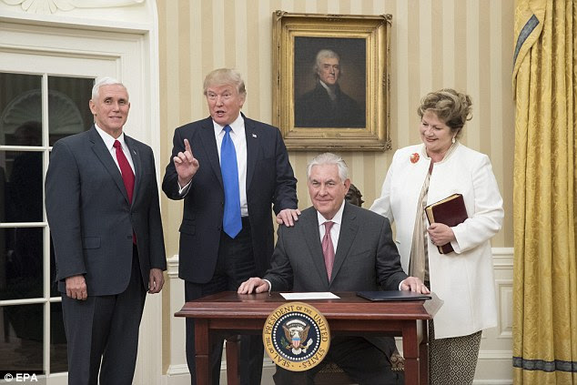 Trump showered Tillerson with praise, saying: 'I do believe we can achieve peace and stability in these very, very troubled times'