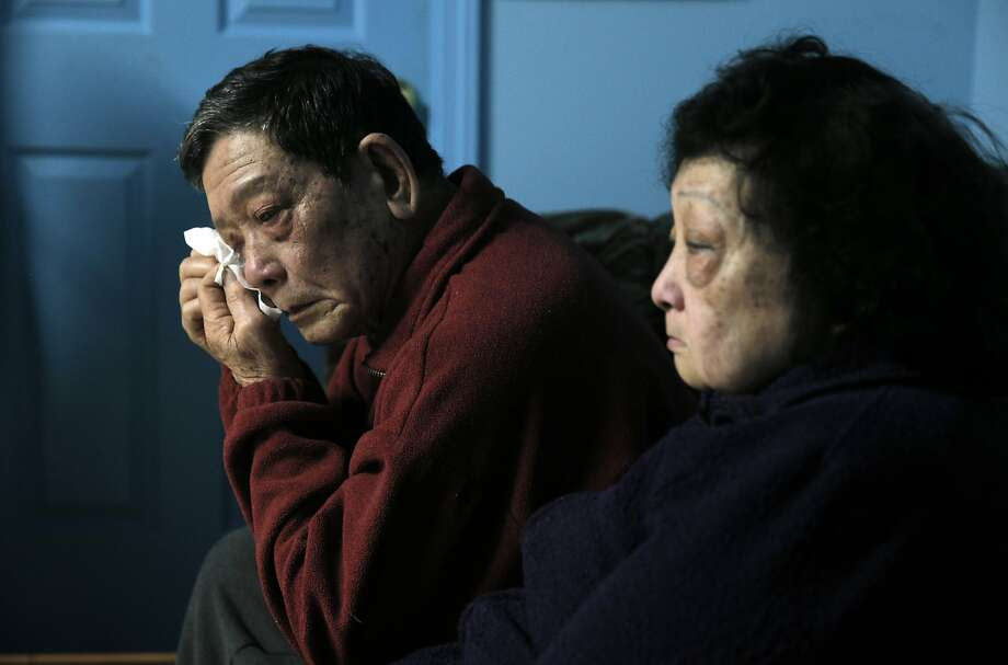 Chien Bui reacts as he and his wife Ai Huynh, remember their son, Vinh Bui in their family home in San Francisco, Calif., on Monday, January 4, 2016.  Five years ago, Vinh Bui, who suffered from mental illness, was shot and killed by SFPD after a family member called for assistance.  His story is one that matches a narrative that has been seen far too often in San Francisco, including most recently that of Mario Woods. Photo: Carlos Avila Gonzalez, The Chronicle