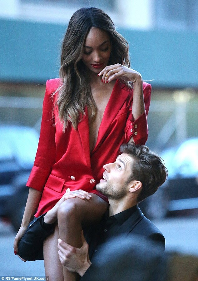Hello there!No doubt lifting the slender star with ease, the male model playfully looked up at Jourdan looking impressed at her glowing good looks