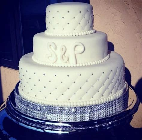 3 tier ivory round wedding cake with silver studs and