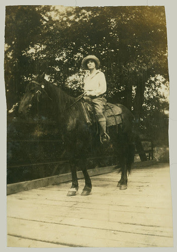 Woman and horse on bridge