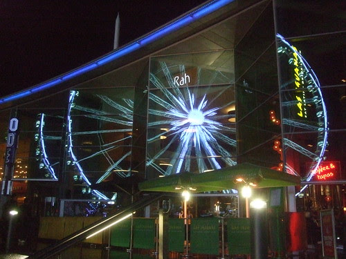 Liverpool's Big Wheel At Night Reflected In Nearby Restaurants
