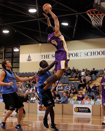 The Sydney Kings' Martin Iti with the monster Alley Oop - Sydney Kings v New Zealand Breakers - Sunshine State Challenge Pre-season NBL Basketball, Southport School, Gold Coast, Queensland, Australia; 22 September 2011. Photos by Des Thureson:  http://disci.smugmug.com.