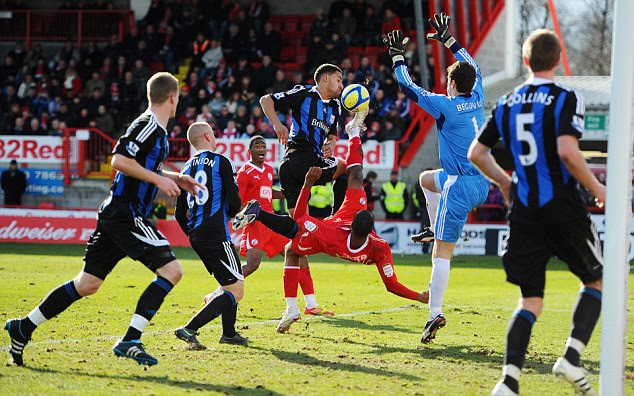 Spectacular effort: Tyrone Barnett attempts a bicycle kick on goal during the Cup clash