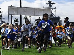 US Navy 100519-N-7498L-053 Children from the Morale, Welfare and Recreation (MWR) Youth Sports Program at Commander, Navy Region Hawaii, participate in a 1.5-mile fun run