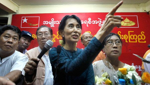 Nov. 14: Pro-democracy leader Aung San Suu Kyi gestures during her first press conference since her release from house arrest in Rangoon, Burma.