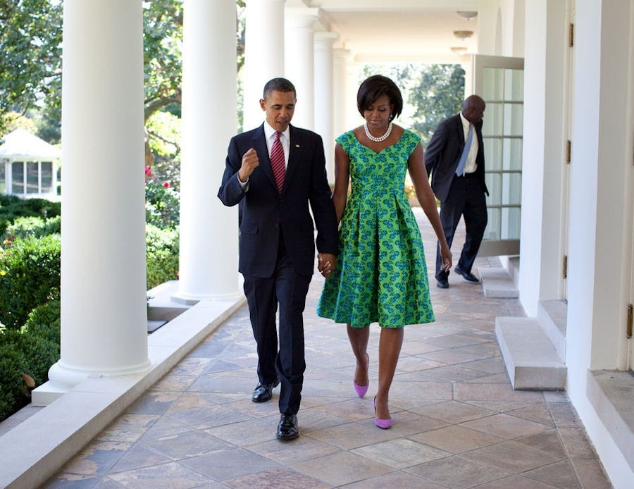 President Obama chats with Michelle as they walk the White House Colonnade in September 2010.