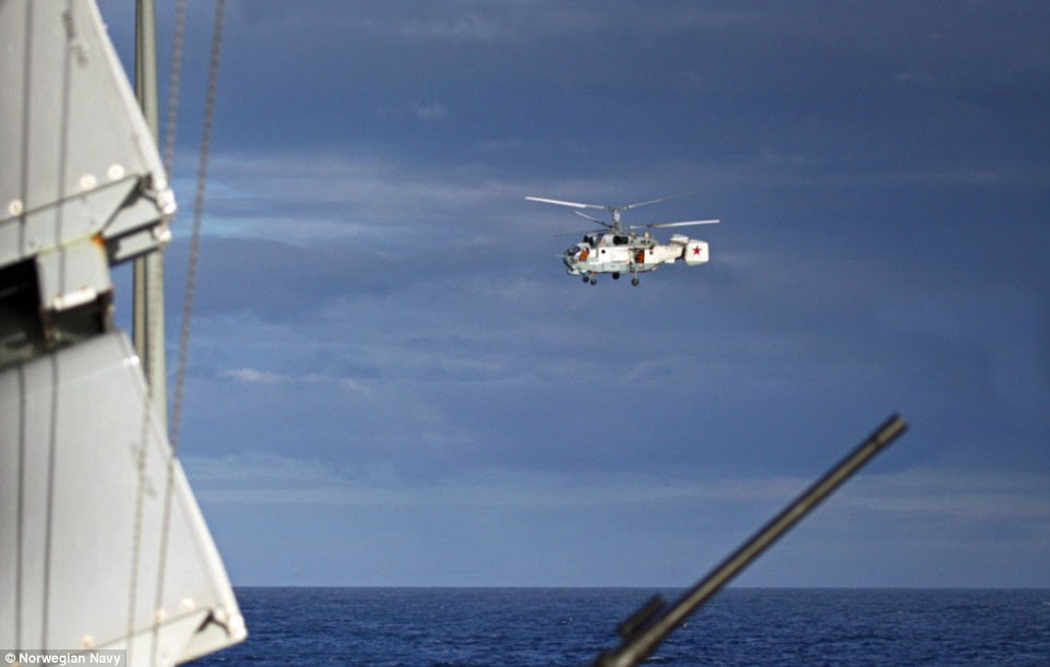 The KA-27s flew close to the NATO vessels monitoring the Russian fleet as it approached the Scottish coast