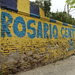 At each turn in the city's north side, walls, streetlights and sidewalks are painted the blue and yellow colors of the Rosario Central club.