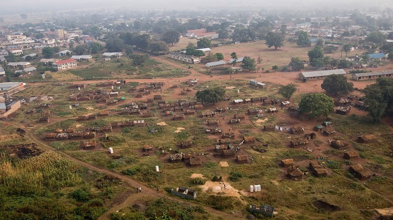 What we see in the fore ground is an IDP (Internally Displaced Persons) camp.There was no such thing as refugee camps for Ugandans before Museveni came to power