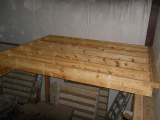 2x4s Attached to Extend Floor Parallel to the Joist Blocks