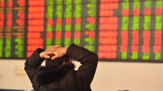 An investor observes the stock market at an exchange hall on 13 January, 2016 in Fuyang, Anhui Province of China