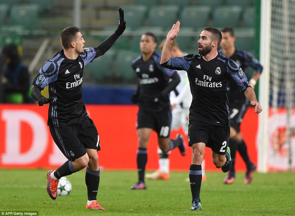 Dani Carvajal and Mateo Kovacic high-five eachother after the Croatian scored a late equaliser to spare Real's blushes