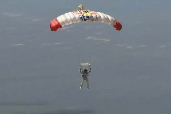 Austrian BASE jumper Felix Baumgartner glides to the ground as he successfully completes his spacedive on October 14, 2012.