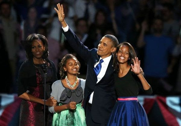 With his family at his side, President Obama gives his victory speech in Chicago, his hometown, after winning the national election on November 6, 2012.