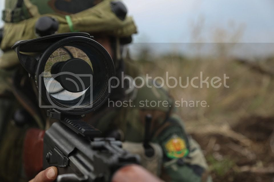 Airsofter aiming down the sights of a gun