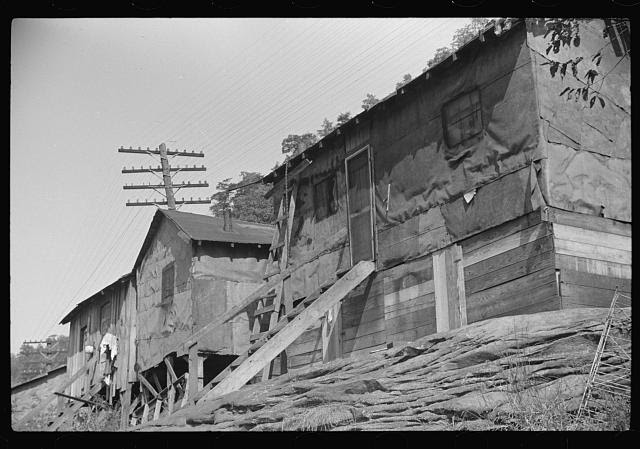Shacks inhabited by Negroes, along river on highway between Charleston and Gauley Bridge, West Virginia