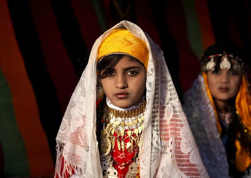 Veiled tuareg girls with jewels in Ghadames, Libya