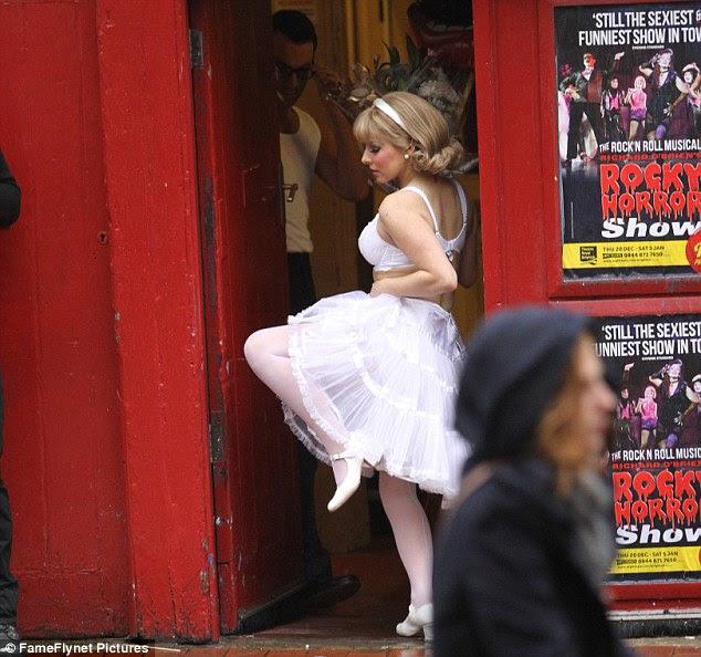 gal dancing in white