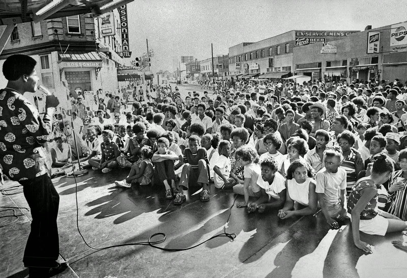 Description of  JUL 4 1970 - Jerry Twiggs of Dee and Jay vocal act performs before a crowd estimated at 1,500 at talent show at Five Points intersection. The show, held on Saturday afternoon, was part of Black Unity Days. (David Cupp/The Denver Post)