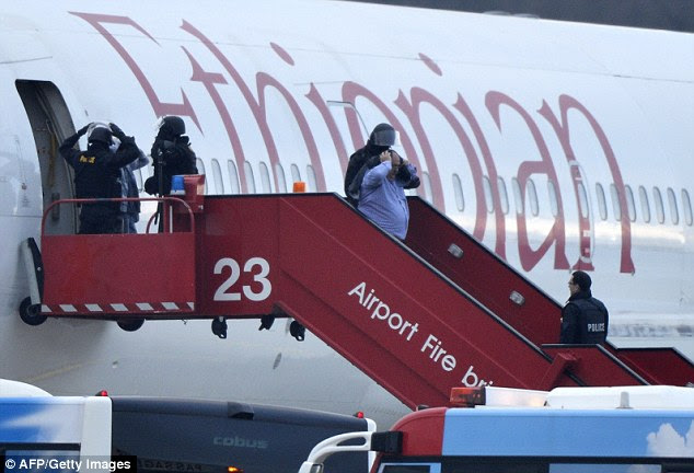 Police evacuate passengers from the Ethiopian Airlines flight