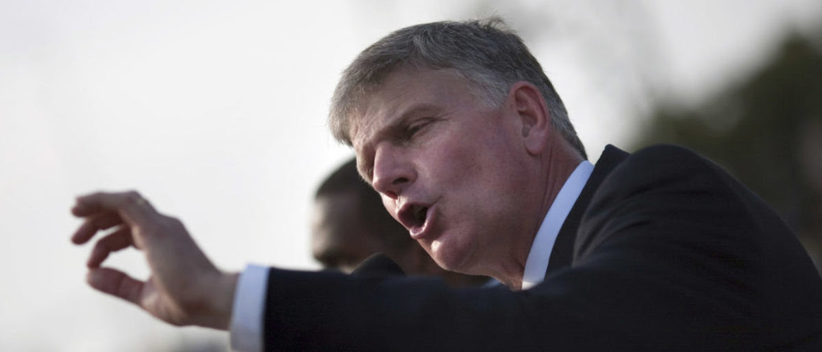 Franklin Graham, son of evangelist Billy Graham, addresses the crowd at the Festival of Hope, an evangelistic rally held at the national stadium in Port-au-Prince, January 9, 2011. REUTERS/Allison Shelley (HAITI - Tags: DISASTER ENVIRONMENT RELIGION) - RTXWDVV