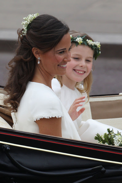 Sister of the Bride and Maid of Honour Pippa Middleton and bridesmaid Margarita Armstrong-Jones make the journey by carriage procession to Buckingham Palace following the Royal Wedding of Prince William, Duke of Cambridge and Catherine, Duchess of Cambridge at Westminster Abbey on April 29, 2011 in London, England. The marriage of the second in line to the British throne was led by the Archbishop of Canterbury and was attended by 1900 guests, including foreign Royal family members and heads of state. Thousands of well-wishers from around the world have also flocked to London to witness the spectacle and pageantry of the Royal Wedding.