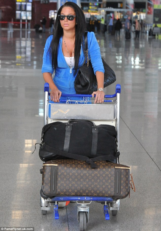 Back to reality: The 24-year-old singer failed to raise a smile as she made her way through arrivals