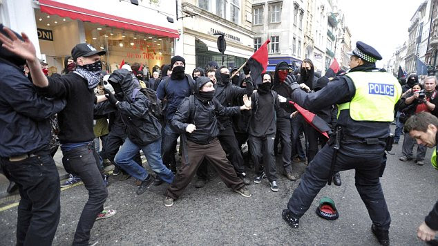 Officers clashing with demonstrators in Oxford Street