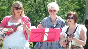Gemma Cullingford (right) and two other members of the Norwich Ukulele Society at a gig outside the Forum in Norwich