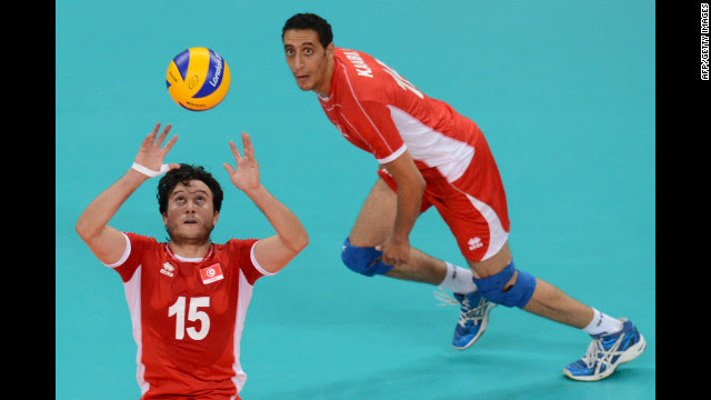 Tunisia's Mehdi Ben Cheikh, left, sets the ball during the men's preliminary volleyball match between Serbia and Tunisia on Tuesday.