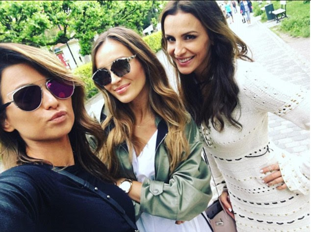 Friendship: Not one to be without her girls, she posted this glam but casual shot with the caption 'Dream Team'