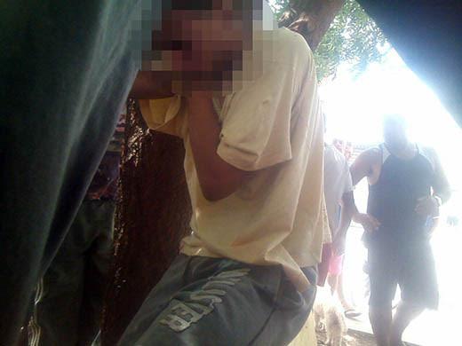 Menor foi preso a árvore e linchado por populares até a chegada da polícia (Foto: Polícia Militar/Divulgação)