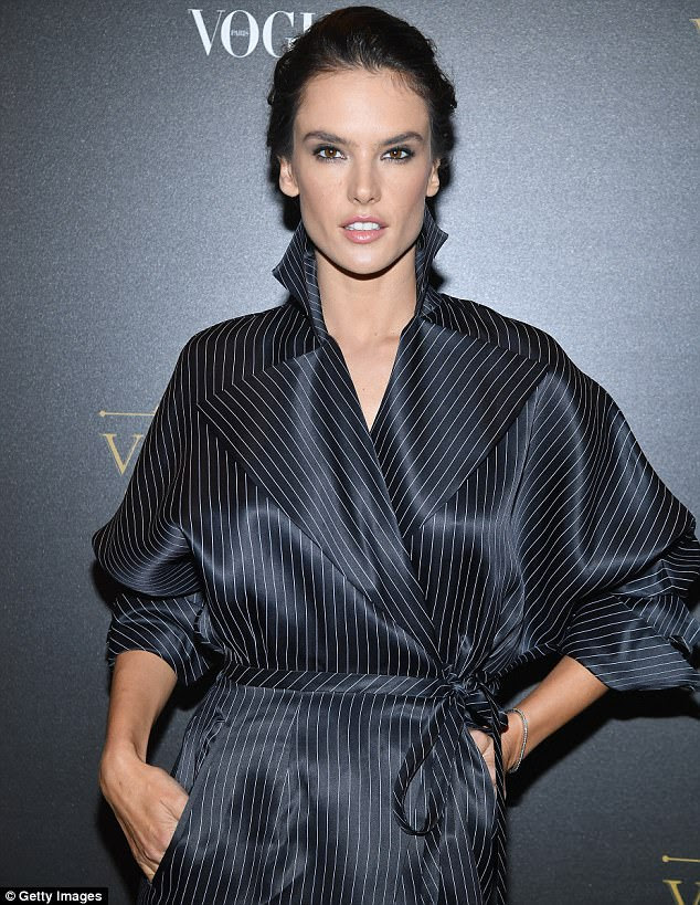 Work it! Alessandra Ambrosio made a style statement in a pinstripe trench coat and a chic bun