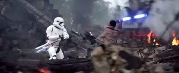 Welding Anakin and Luke Skywalker's old lightsaber, Finn (John Boyega) takes on a First Order riot trooper in STAR WARS: THE FORCE AWAKENS.
