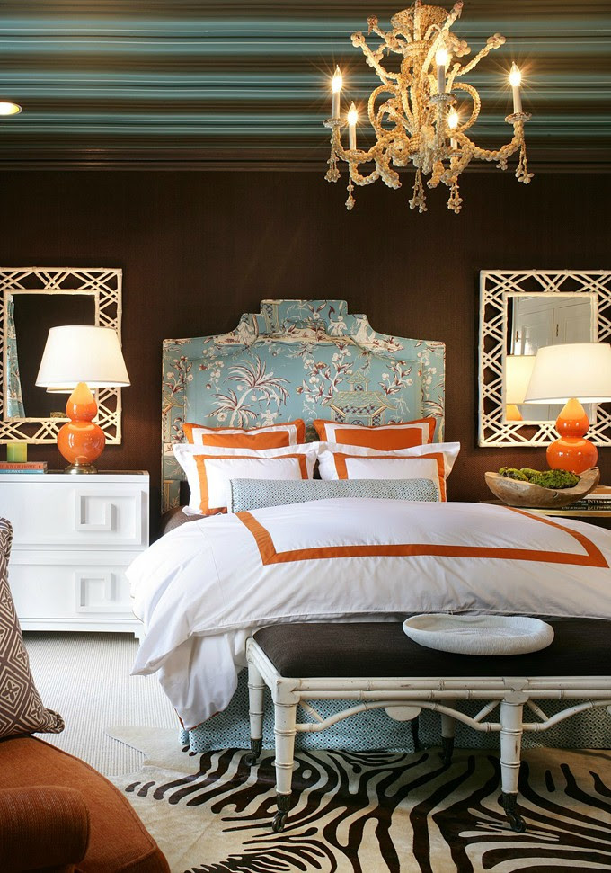 chocolate brown walls orange accents china seas upholstered headbooard bedroom white lacquered nightstand bamboo mirrors