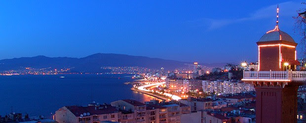 """Beautiful Izmir"", lies on the shore of a long and narrow gulf,  furrowed by ships and yachts. Palm-lined promenades and avenues follow the shoreline, and the city gently ascends the..."