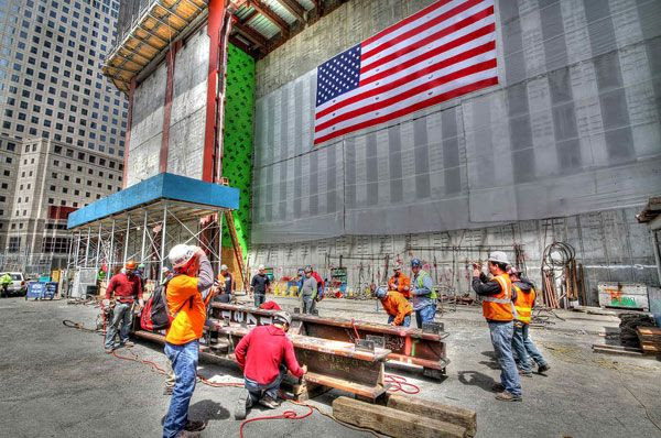 Workers sign the steel column that made the 1 World Trade Center (1 WTC) the tallest building in New York City (NYC), on April 30, 2012.