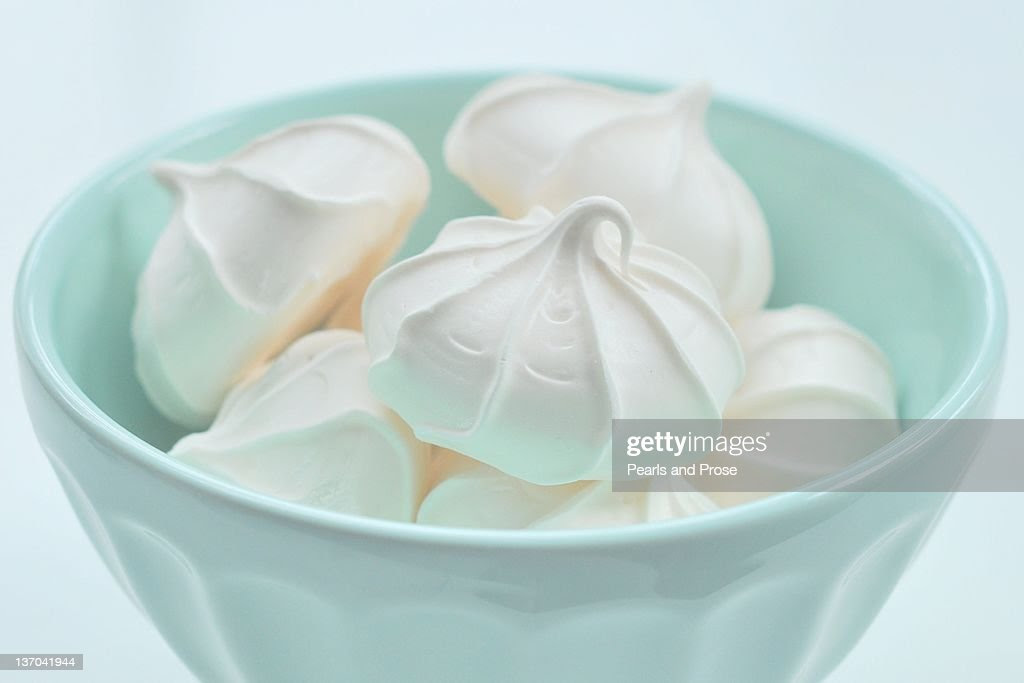 White Meringue Cookies In Pastel Blue Bowl Stock Photo