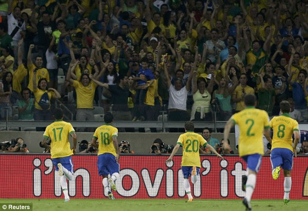 Joy: Brazil booked their place in the final of the Confederations Cup with a 2-1 win over Uruguay