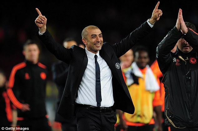 All smiles: Di Matteo celebrates the most unlikely of victories after Torres rounded Valdes to score the second
