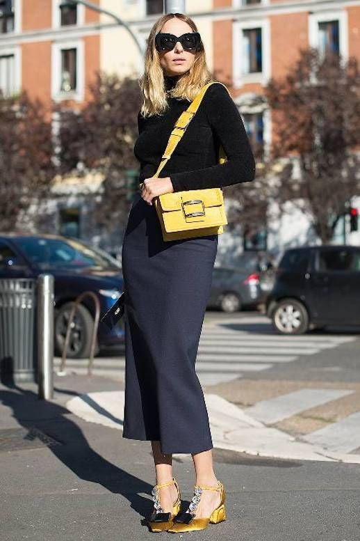 Le Fashion Blog Candela All Black Outfit Black Oversized Sunglasses Black Turtleneck Yellow Shoulder Bag Black Midi Skirt Yellow Embellished Heels Via Who What Wear