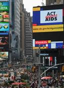 Photo of New York Jumbotron with Act Against Aids logo