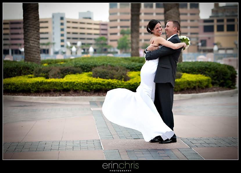 groom spinning bride on the tampa riverwalk
